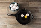foto of yoke  - Raw eggs in frying pan with yoke showing - JPG