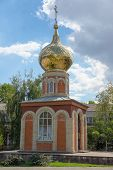 pic of chapels  - red and white bricks orthodox chapel with golden dome - JPG