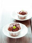 stock photo of chocolate muffin  - Chocolate muffins with chocolate on white plate - JPG