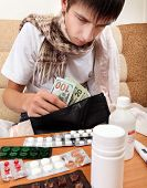 picture of home remedy  - Sick Young Man check the Wallet with the Money on the Sofa at the Home  - JPG