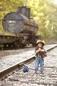 image of railroad car  - Adorable toddler on the railroad tracks and dressed as a hobo - JPG