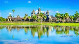 stock photo of shiva  - Angkor Wat temple with palms and reflection in the lake over the blue sky i - JPG