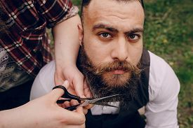 pic of shaved head  - two strong stylish  bearded men shave outdors - JPG