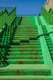 picture of stairway  - Green concrete stairs stairway with railing handrail on sunny day - JPG