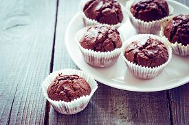 foto of chocolate muffin  - Chocolate muffins with chocolate on white plate - JPG