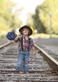 picture of hobo  - Adorable toddler on the railroad tracks dressed as a little hobo - JPG