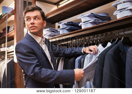 Smiling businessman in store