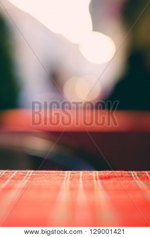 Empty red table and blur resturant background, street view, abstract