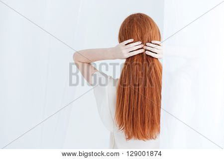 Back view portrait of redhead woman