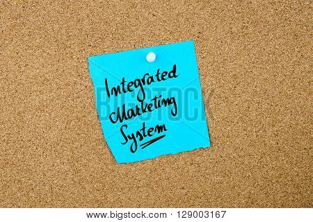 Integrated Marketing System Written On Blue Paper Note