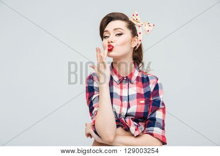 Pretty lovely pinup girl  in checkered shirt touching her lips