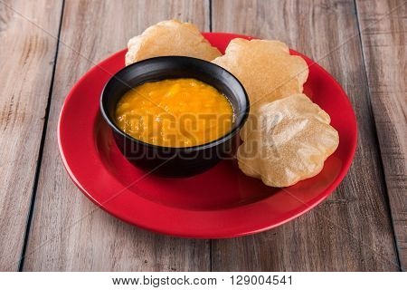 Aamras or Aam Ras Puri: Puri which is an indian fried small bread and alphonso mango pulp is a popular lunch especially during Padwa, the Marathi new year, maharashtrian lunch/dinner menu