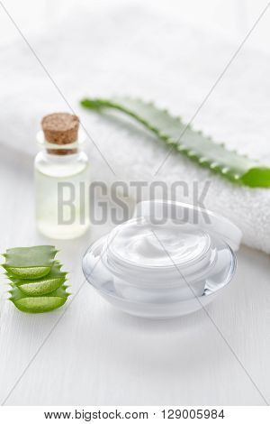 Aloe vera anti wrinkle cosmetic cream in product container on white background. Skin face and body care hygiene moisture lotion wellness natural healthy dermatology medicine therapy mask treatment.