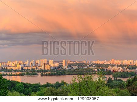 View of Kiev city from Botanic Garden before storm at sunset