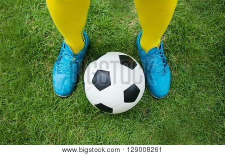 Football or soccer ball at the kickoff of a game.