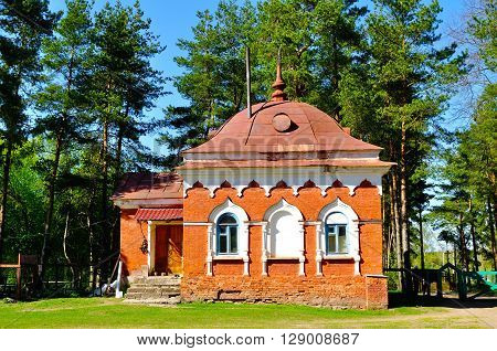 Building of red brick built in the 19th century to the cells of the monks hermits. Peryn Skete in Veliky Novgorod Russia. Architecture spring landscape.