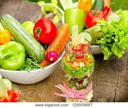 Eating healthy food, healthy diet - organic vegetables in jar and in bowl