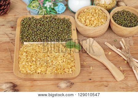 Soy beans and dry beans on wood background