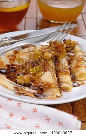 Pancakes apple slices with caramel and chocolate