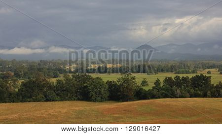 Autumn scene in rural New South Wales Australia. Farmland forest and hills. Landscape in Telegraph Point small village near Wauchope.