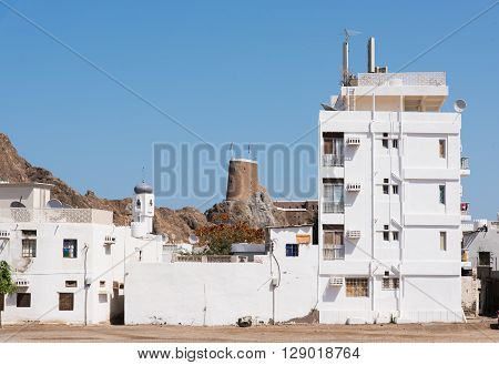 Residential area in Muscat The Sultanate of Oman with the ancient Fort Al-Mirani in the background.