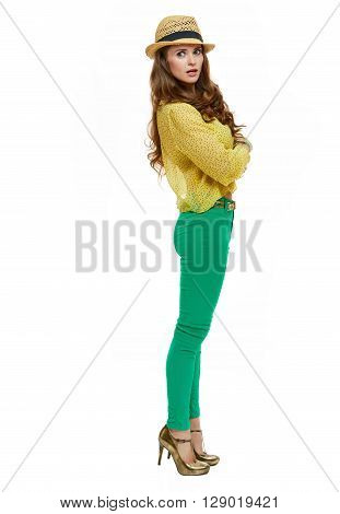 Colourful vibes. Full length portraits of surprised brunette woman in hat and bright clothes looking aside