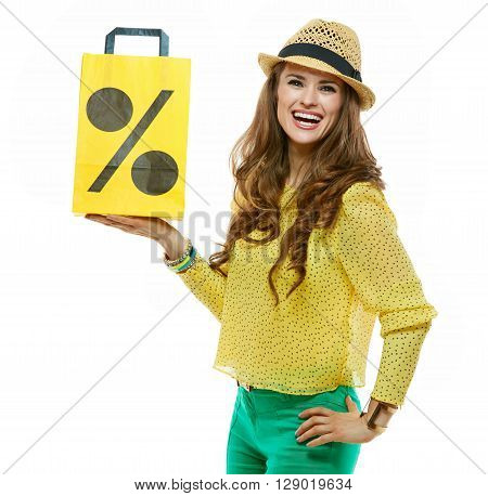 Woman In Hat Showing Shopping Bag Symbolising Beginning Of Sales