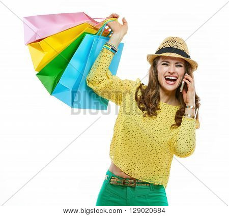 Woman In Hat With Shopping Bags Talking Cell Phone And Rejoicing