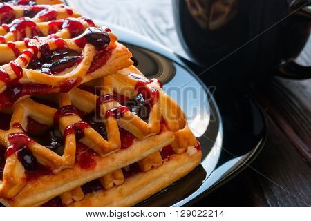Biscuits With Plum Jam On A Black Background