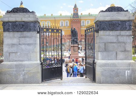 MOSCOW RUSSIA - April 24.2016: Tourists and citizens walking on the territory of the Alexander Garden near the monument to Patriarch Hermogenes near the Kremlin