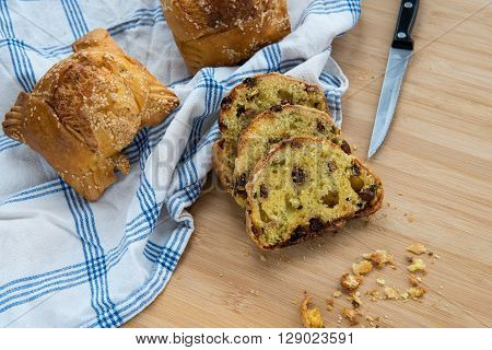 Traditional Cypriot easter cheese pastries flaounes and knife.