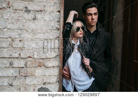 Photo of a young beautiful couple in an old doorway