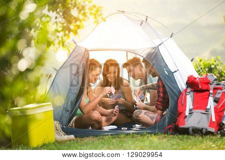 young fiends have fun in tent on camping trip