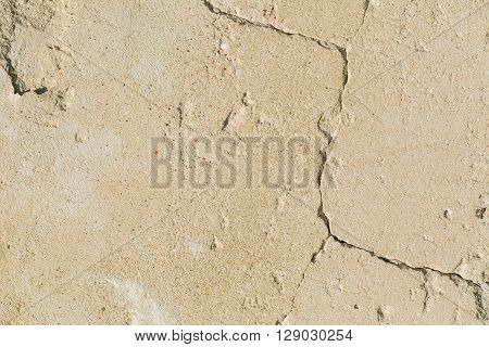 Old concrete wall background. Destroyed wall with cracks.