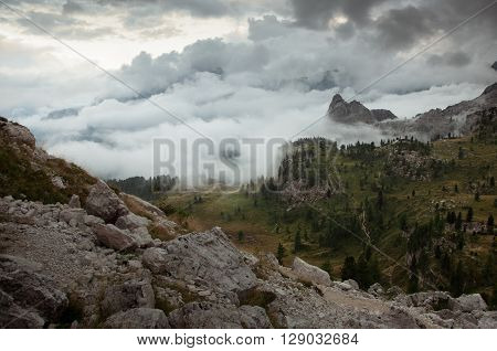 Misty dolomite valley just before sunset time