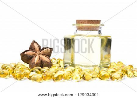 Sacha Inchi Oil In Translucent Bottle And Oil Capsules On White Background