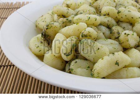 Gnocchi pasta close up in white plate