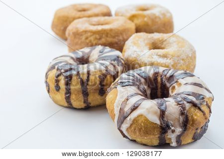 Various dougnuts close up isolated on white background