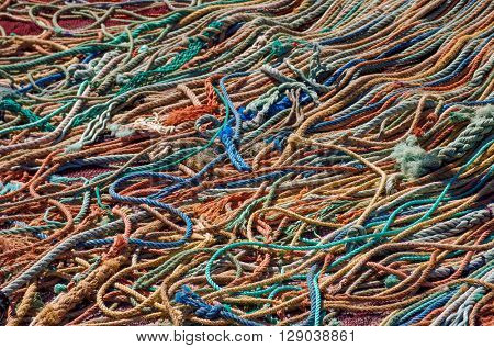 Background of colorful old fishing ropes under sunlight