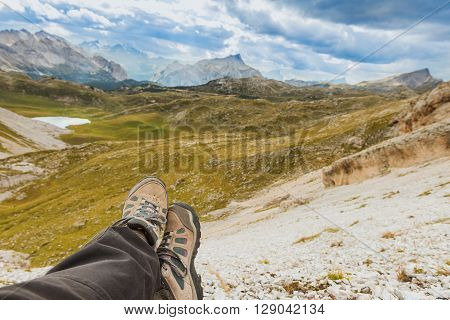 Hiker relaxing in hight mountains, Alps, Italy