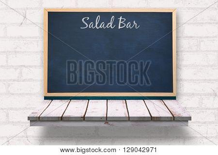 Salad bar message against blackboard on a wooden shelf