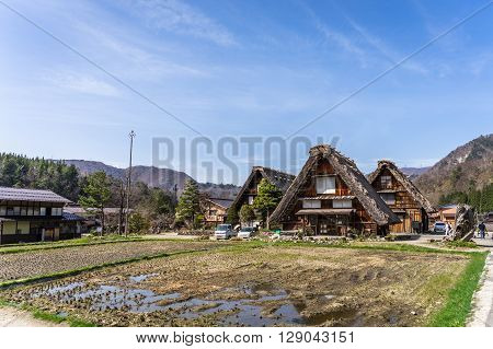SHIRAKAWA-GO, JAPAN - 9 April 2016: Local farmers cultivate their land for plantation in Shirakawa-go traditional village, Japan