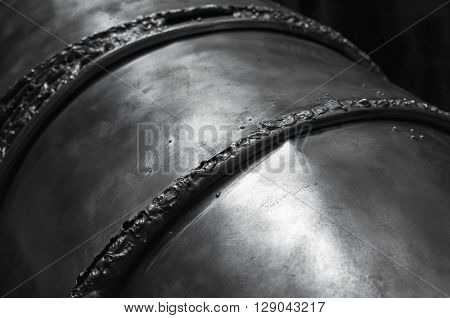 Black Shining Metal Surface With Weld Seams