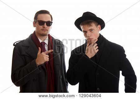 Two young adults in coats on white background