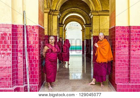 Mandalay Myanmar - January 13 2012: Monks in the Mahamuni Paya temple.