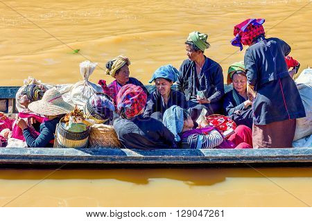 Inla Lake. Myanmar - January 14 2012: Shan State local women on a water transport boat
