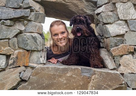 A beautiful young woman with her black schnauzer