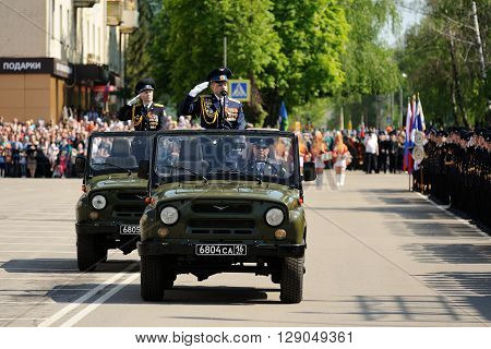 Orel Russia - May 9 2016: Celebration of 71th anniversary of the Victory Day (WWII). Commanders in chief saluting from cars in parade horizontal