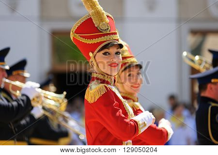 Orel Russia - May 9 2016: Celebration of 71th anniversary of the Victory Day (WWII). Girls in red hussar uniform marching closeup