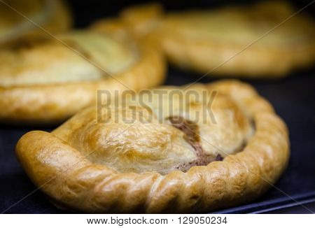 Close up of a traditional Cornish Pastie on a hot counter in canteen
